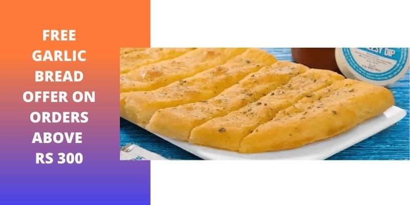 dominos free garlic bread offer
